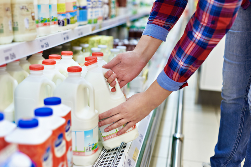 Woman shopping milk in store