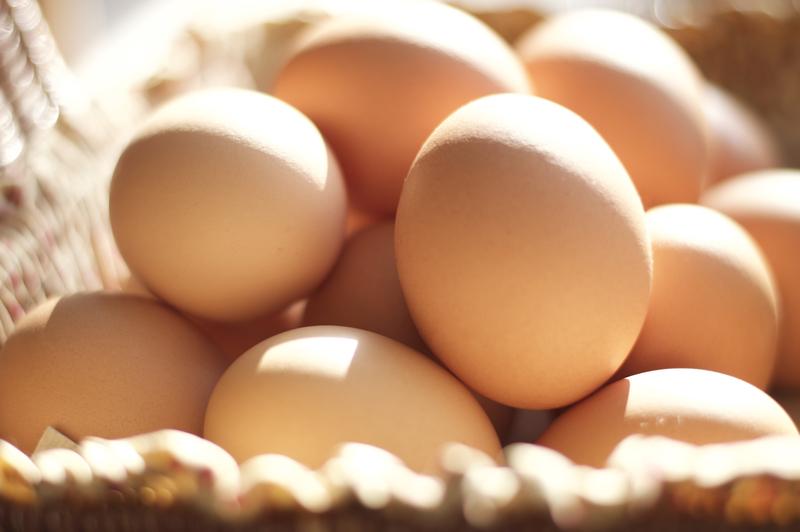 Brown eggs in a brown basket